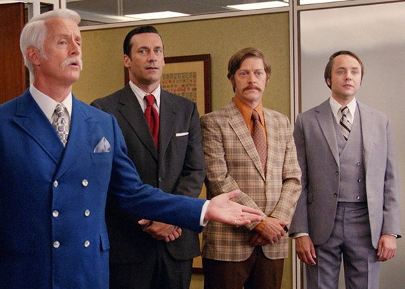 John Slattery as Roger Sterling, Jon Hamm as Don Draper, Kevin Rahm as Ted Chaough, and Vincent Kartheiser as Pete Campbell in Mad Men.