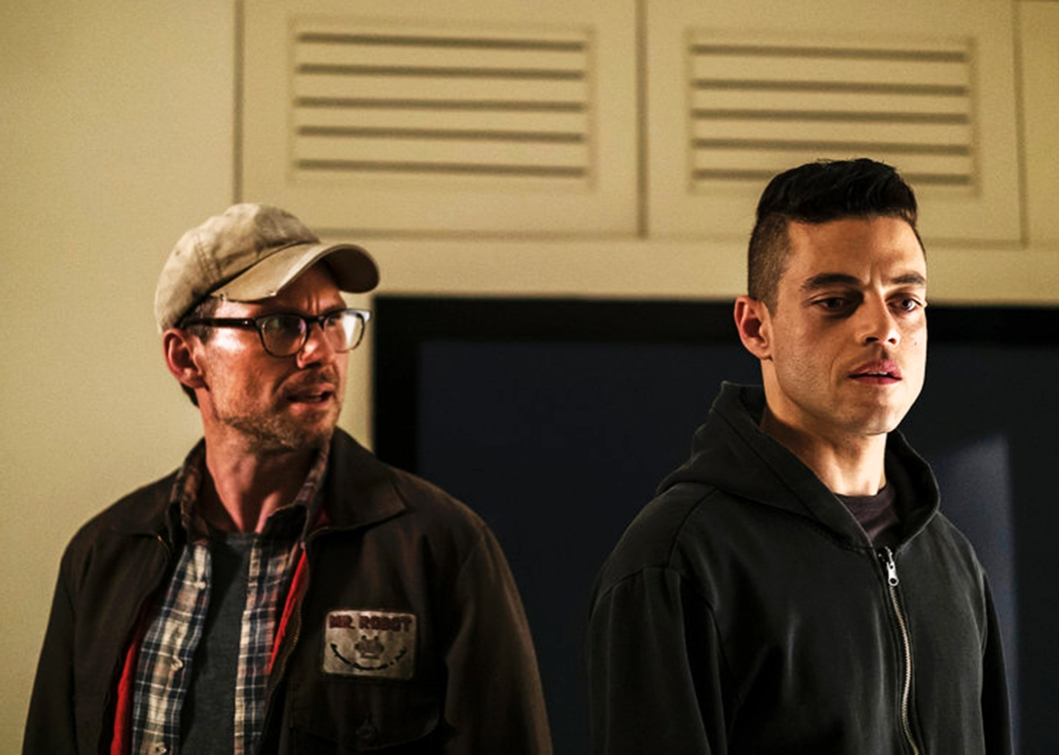 "Christian Slater as Mr. Robot, Rami Malek as Elliot Alderson in ""Mr. Robot""."