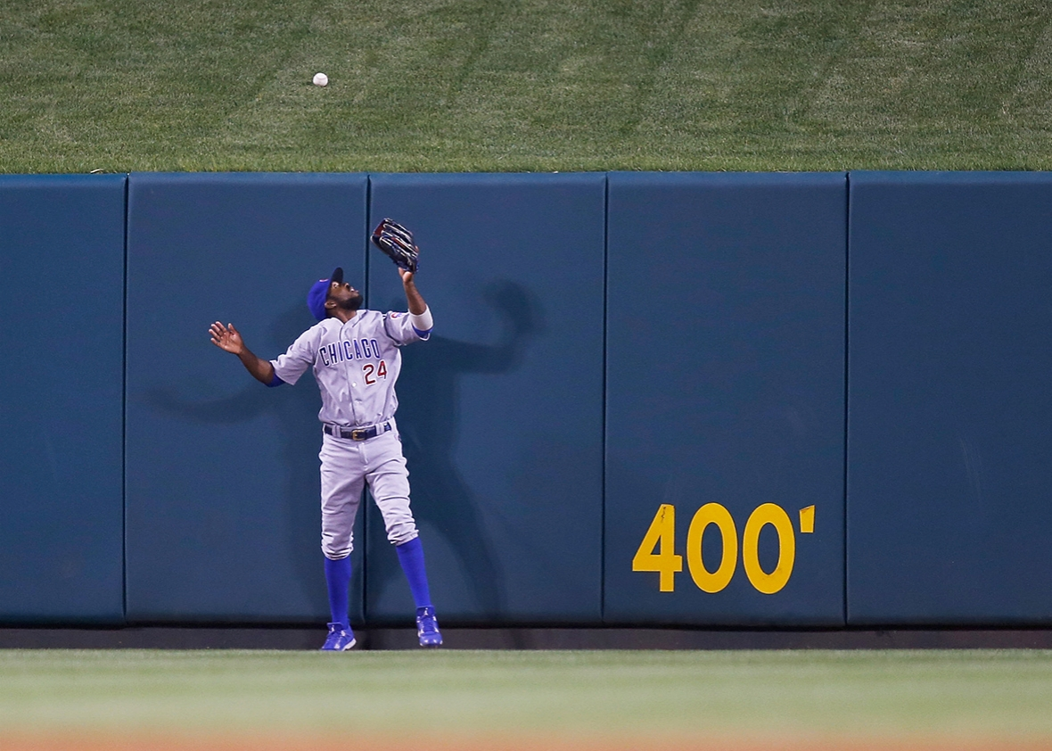 Dexter Fowler #24 of the Chicago Cubs watches as a home run ball hit by Matt Adams #32 of the St. Louis Cardinals lands over the centerfield wall during the seventh inning at Busch Stadium on May 23, 2016 in St. Louis, Missouri.