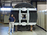 Detector used to find charged particles, which has since been replaced, with physicist for scale