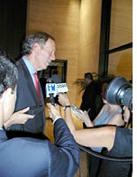 New York Gov. George Pataki with reporters after his address