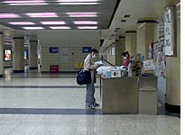 Lonely newsstand in Wangfujing subway station