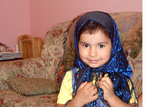 Larissa plays dress-up with a traditional gypsy scarf