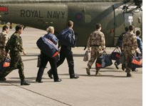 Marines and sailors held captive by Iran return to London.  Click image to expand.