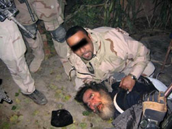 Saddam's capture. Click image to expand.