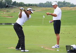 Tiger Woods works on his swing. Click image to expand.