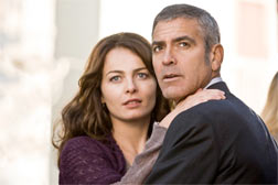 "Violante Placido and George Clooney in ""The American"". Click image to expand."