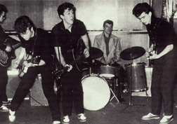 The Silver Beetles audition session: Stuart Sutcliffe, John Lennon, Paul McCartney, Johnny Hutchinson, and George Harrison, May 1960.. Click image to expand.