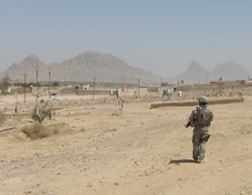 An MP stands guard near a construction site in Kandahar. Click image to expand.