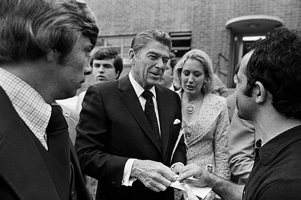Presidential candidate Ronald Reagan signs autographs.
