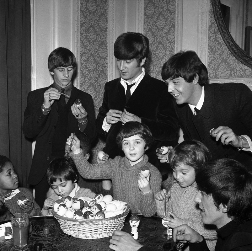 The Beatles provide both inspiration and instruction for Church of England Children's Society orphans as they paint mop topped Easter eggs.