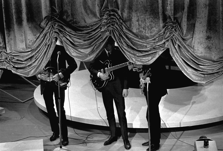 The curtain rises on the British singing group The Beatles, September 16, 1964, at a charity show in New York City.