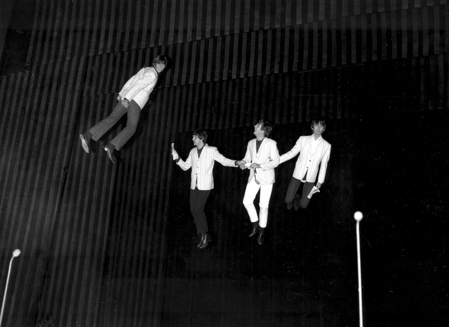 "The Beatles, from left, Ringo Starr, Paul McCartney, John Lennon and George Harrison, are suspended in midair above the stage during rehearsal for their part in the charity show ""Night of 100 Stars""."