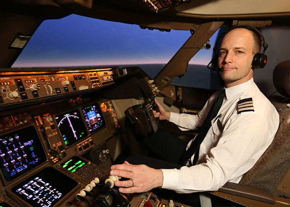 Mark Vanhoenacker in the cockpit of a Boeing 747-400.