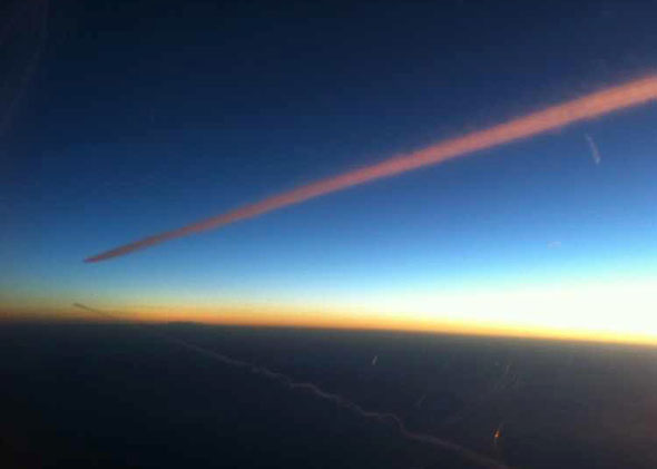 Twin contrails at dawn over the Mediterranean, en route from Cap