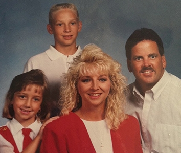 The Monroe family circa 1998: Ashley, age 11, with her brother Chad, her mother Kellye, and her father Larry.