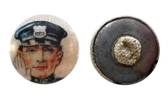 A fabric-printed garter button, used by flappers to hold up their newly-visible stockings.