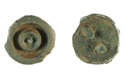 Prehistoric copper-alloy button, dating from the late Bronze Age, circa 900 BC, to the early Iron Age, circa 43 AD.