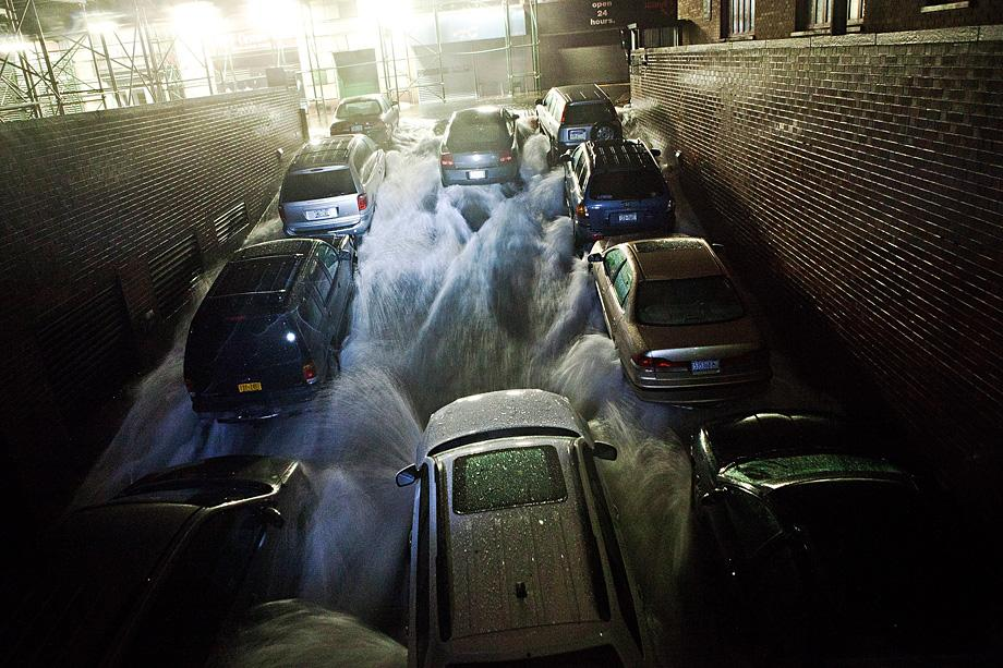Rising water, caused by Hurricane Sandy, rushes into a subterranian parking garage on October 29, 2012.