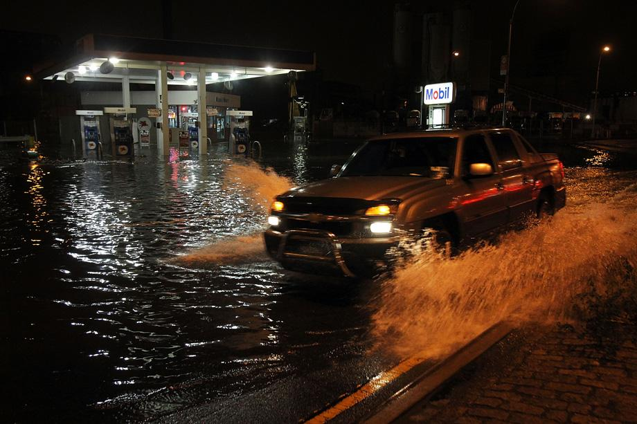 A truck drives by a flooded gas station in the Gowanus section of Brooklyn as Hurricane Sandy affects the area on October 29, 2012 in New York.