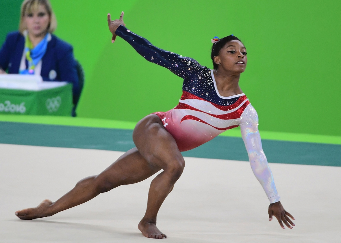 US gymnast Simone Biles competes in the Floor event during the women's team final Artistic Gymnastics at the Olympic Arena during the Rio 2016 Olympic Games in Rio de Janeiro on August 9, 2016.