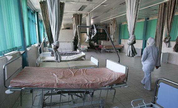By Charles Webb. A Nurse Walks Past Empty Beds At The Government Run  Hospital In The Northern West Bank
