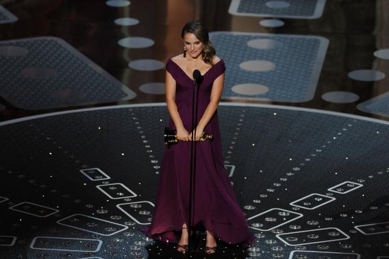 Actress Natalie Portman accepts the award for Best Performance by an Actress in a Leading Role for 'Black Swan'.
