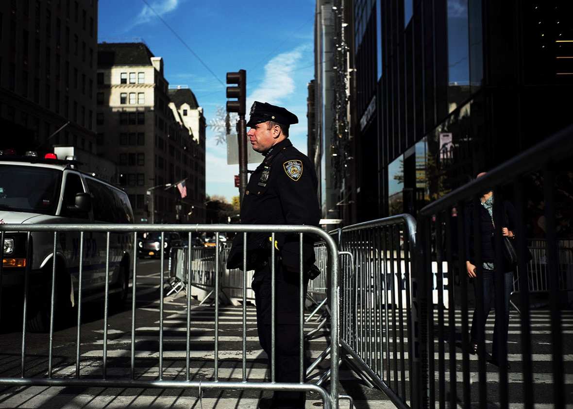 New York Police Department (NYPD) officers guard near Trump Tower, where US President-elect Donald Trump holds meetings, in New York on November 14, 2016.