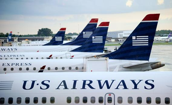 U.S. Airways planes sit on the tarmac at Charlotte/Douglas International Airport in September 2012 in Charlotte, North Carolina.