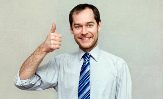 Smiling Young Office Worker Showing Thumbs UP Sign