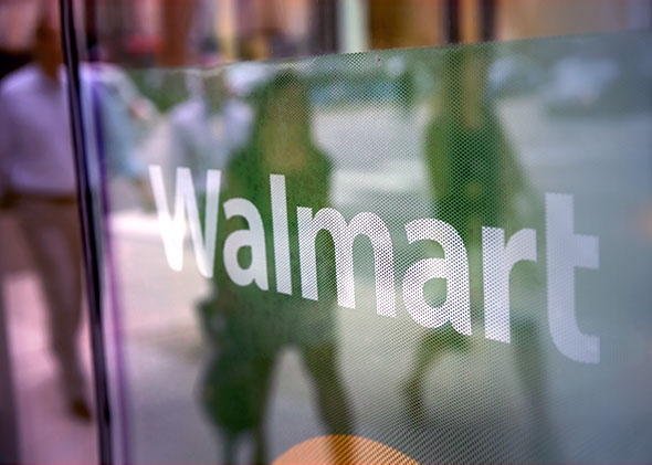 The Walmart logo is displayed in the window of a Walmart Neighborhood Market store on August 15, 2013 in Chicago, Illinois.
