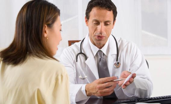 Doctor explaining something to a patient.