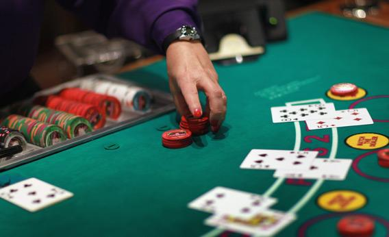 A dealer works the blackjack table.