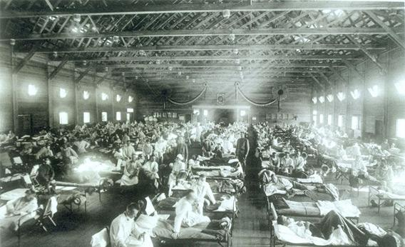 Historical photo of the 1918 Spanish influenza ward at Camp Funston, Kansas.
