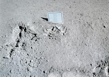 A close-up view of a commemorative plaque left on the moon at the Hadley-Apennine landing site in memory of 14 NASA astronauts and USSR cosmonauts, now deceased.