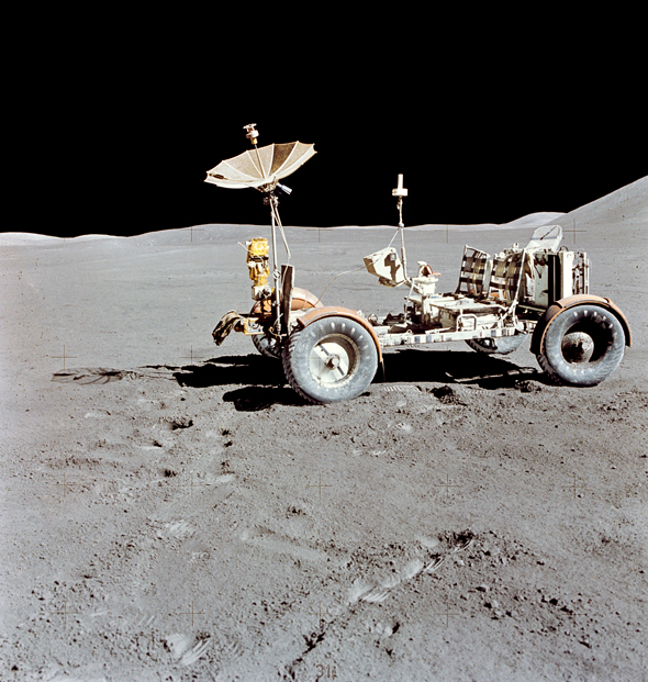 The Lunar Roving Vehicle (LRV) photographed alone against the desolate lunar background during the third Apollo 15 lunar surface extravehicular activity (EVA) at the Hadley-Apennine landing site, August 1971.