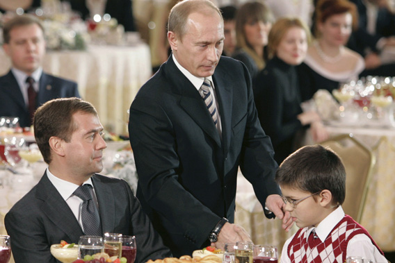Russia's First Deputy Prime Minister Dmitry Medvedev (left) and President Vladimir Putin (center) attend the opening ceremony of the Year of the Family in Moscow's Kremlin, Dec. 24, 2007.