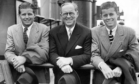 John Fitzgerald Kennedy, right, and his brother Robert, left, surround their father, Joseph