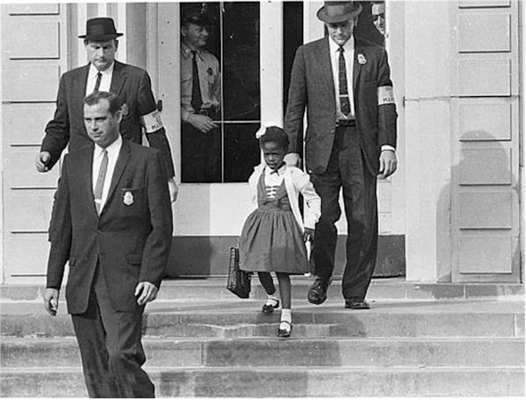 After a federal court ordered the desegregation of schools in the South, U.S. Marshals escorted a young black girl, Ruby Bridges, to school on November 14, 1960, in the midst of racial tension and violence. Bridges attended William Frantz Elementary School in New Orleans and with U.S. Marshals by her side; she became the first black child to enter an all-white school in the history of the American South.