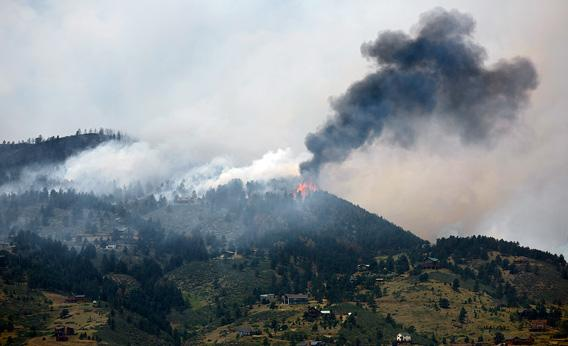 Flames and smoke erupt atop a ridge near Horsetooth Reservoir on June 11, 2012 near Laporte, Colorado.