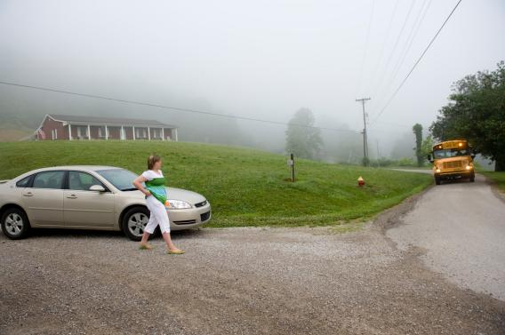 Carlin Robinson, 12, walks from her grandmother's car to the school bus in Manchester, Ky. Her house can be seen in the background. A study published in 2010, investigating high obesity rates in the town found that residents used cars to minimize walking distance, to the detriment of their health. Photograph by Linda Davidson / The Washington Post via Getty Images.