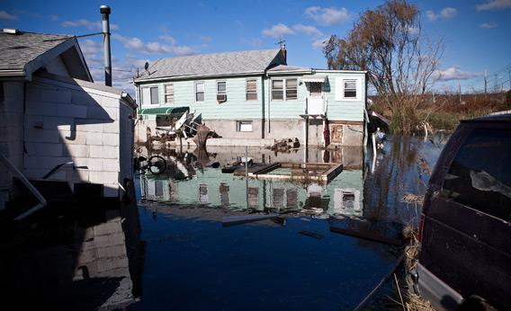 A seriously damaged home is seen in the flooded Midland Beach neighborhood of Staten Island on Saturday in New York City.