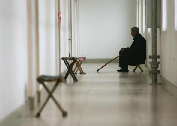 74215712-senior-citizen-sits-at-the-corridor-of-a-care-center-on