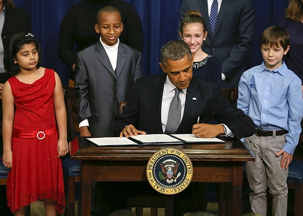 President Obama signs a series of executive orders on new gun-law proposals on Jan. 16 in Washington.