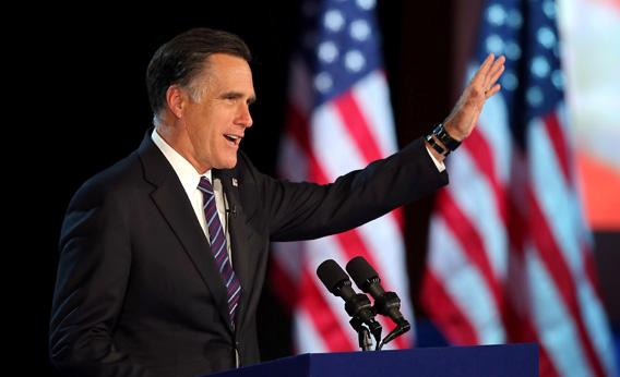 Mitt Romney, waves to the crowd while speaking at the podium as he concedes the presidency.