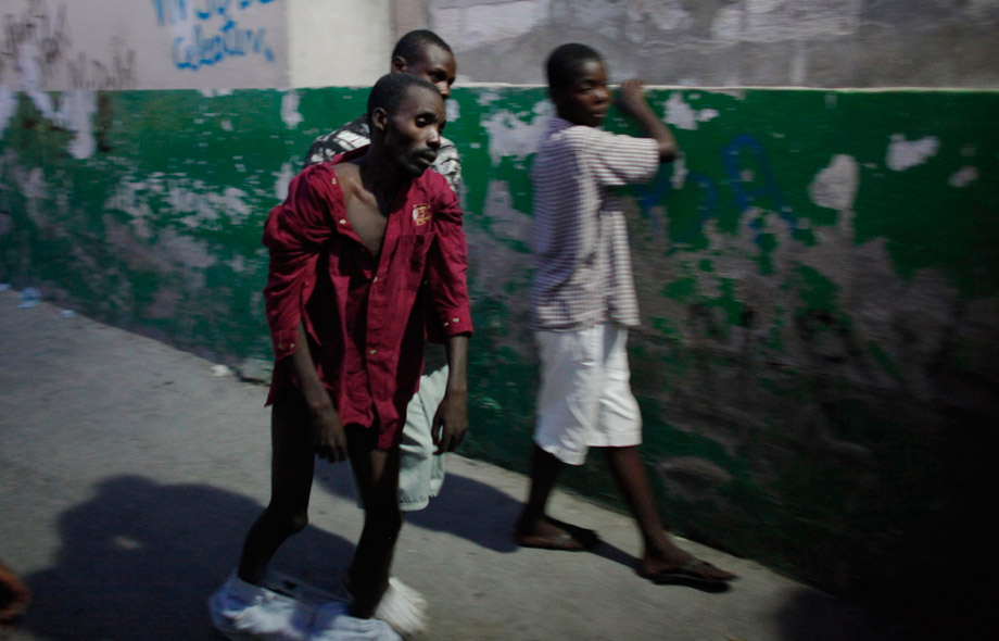 "A Haitian with cholera arrives to receive treatment at St.-Catherine hospital in the slum of Cite-Soleil in Port-au-Prince, Nov. 19, 2010. The United Nations-led international response to Haiti's deadly cholera epidemic is ""inadequate"" and woefully short of funding and aid groups, including the U.N. humanitarian agency."