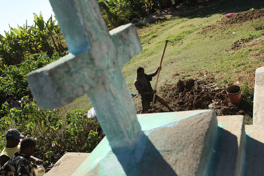 Cemetery workers cover the grave of Serette Pierre, who recently died of cholera, Oct. 29, 2010, in Back D' Aguin, Haiti. Pierre died the same day she contracted cholera, leaving three children without parents. Haiti, one of the poorest nations in the western hemisphere, has been further unsettled by an outbreak of cholera, which has so far killed over 300 people. The epidemic has affected the central Artibonite and Central Plateau regions with 3,612 cases so far on record. Authorities believe the outbreak is contained, but has not yet peaked. There is also fear that the deadly diarrheal disease could migrate to the sprawling camps for the hundreds of thousands of Haitians displaced by the January 2010 earthquake.