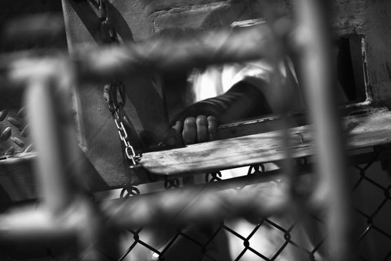 "A detainee waits for lunch inside the U.S. detention center for ""enemy combatants"" on September 16, 2010 in Guantanamo Bay, Cuba."