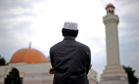 A Muslim takes part in a special morning prayer to start Eid-al-Fitr festival, marking the end of their holy fasting month of Ramadan, at a mosque in Silver Spring, Maryland, on August 19, 2012.