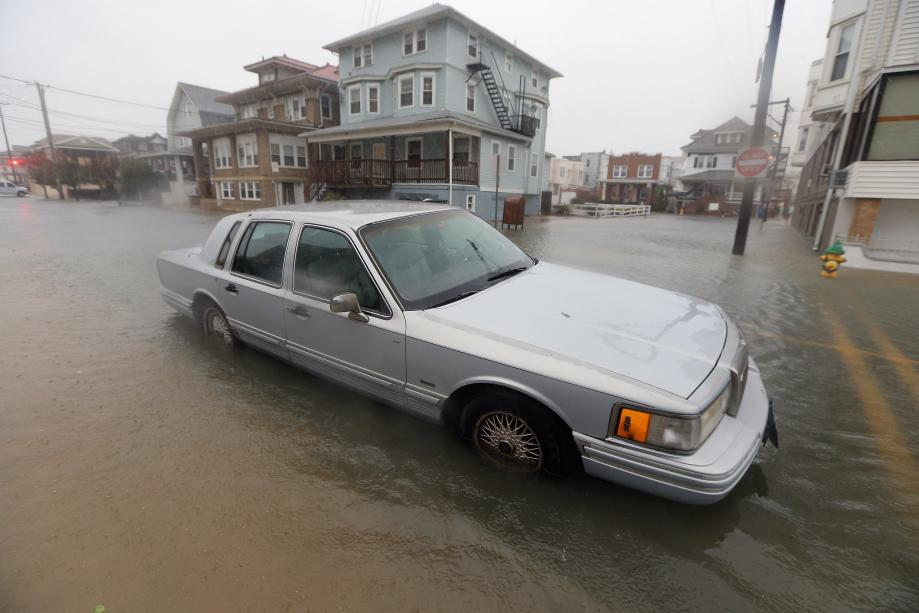 A car sits in a flooded street near the ocean ahead of Hurricane Sandy on Monday in Atlantic City, New Jersey.